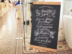 A hand-drawn chalkboard signage for Augustus & Synne's Wedding at Chijmes Hall, Singapore.