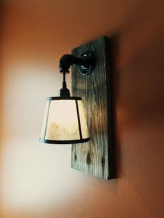 Rustic Barnwood wall light by TimberSteelCo on Etsy, $59.95