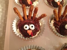 "Turkey ""cupcakes"" for kids allergic to milk, egg, wheat, oat, & peanuts. The ""cupcake"" is a rice crispie treat made with coconut oil instead of butter. The ""feathers"" are gluten-free, dairy-free, egg-free pretzels. The ""heads"" are squished ""enjoy life"" double chocolate chip cookies. Most importantly, our little girls and all the kids (even without allergies!) loved them! No one had any idea they were ""allergy-free."""