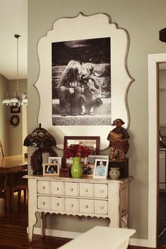 love this extra large frame idea for a smaller wall + the cute cubby