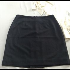 Banana republic skirt size 4 navy blue Bought never wore, still has stitching on slit. Banana Republic Skirts