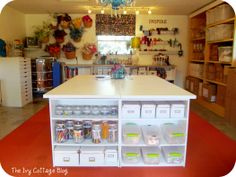 Another view of awesome craft space love the gutters for ribbon and clear containers.