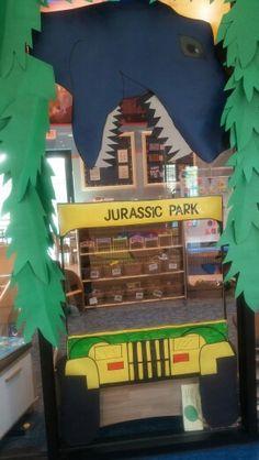 Jurassic park classroom/photo prop Dinosaur Classroom, Dinosaur Theme Preschool, Dinosaur Activities, Preschool Classroom, Jurassic Park Party, Dinosaur Birthday Party, Birthday Board, Reading Themes, Classroom Themes
