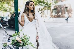 Brent and Jaimme's unforgettable New York City wedding, featuring our effortlessly chic Arlo gown.