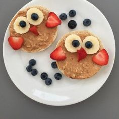 Warm English Muffin with peanut butter and cute shaped fruits. Yum!