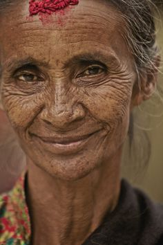 Kathmandu, Nepal To me she is beautiful! Wrinkles are nothing to be ashamed of they are the story of your life.