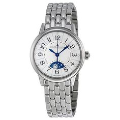 Stainless steel case with a stainless steel bracelet. Fixed bezel. Silver dial with blue-toned hands and Arabic hour markers. Minute markers around the outer rim. Dial Type: Analog. Moonphase window. ...