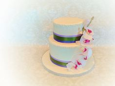 Simplistic beauty...Two tiered red velvet wedding cake accented in ribbon and silk flowers.  www.facebook.com/finishingtouchesbyliz