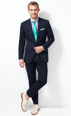 Navy Suit. Turquoise tie. White shoes.