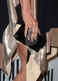 Kesha- Opaque peach polish and boldly outlined in black