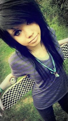 Love her hair cut, color. And awesome skateboard. Love the black N white check-erd. (: