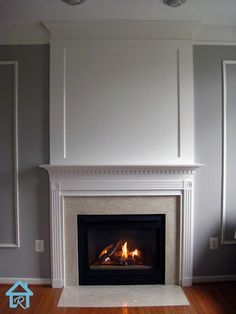 Visual Interest and Height to your Fireplace How to beef up your fireplace wall and make it a focal point with inexpensive trim and MDF.How to beef up your fireplace wall and make it a focal point with inexpensive trim and MDF. Fireplace Molding, Fireplace Redo, Fireplace Remodel, Living Room With Fireplace, Fireplace Design, Home Living Room, Fireplace Ideas, Craftsman Fireplace, Fireplace Mantles