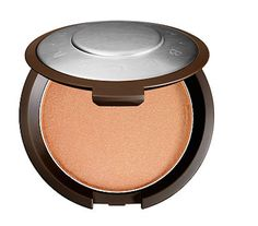 Becca x Jaclyn Hill Shimmering Skin Perfector in Champagne Pop   26 Beauty Products Our Readers Loved In 2015