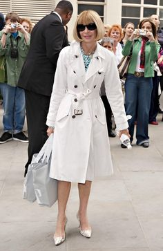 Anna Wintour Trenchcoat - Anna looked polished in a classic trenchcoat with a tied waistline and brass hardware.