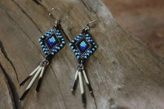 "Beaded earrings // Real porcupine quills // Black and blue // Quality ""delicas"" beads // No animal threatened // Original pattern"