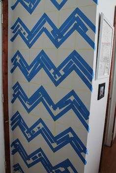 """Easy DIY Chevron Wall instructions! This is the beast tutorial I have ever read for a Chevron wall that doesn't include buying a morbidly expensive stencil. Plus it's like """"painting chevron for dummies"""". So doing this technique in baby girl's nursery!!!"""