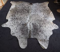 A BEAUTIFUL COWHIDE - A FINE PEPPERING OF JET BLACK & ROAN ON A PURE WHITE…