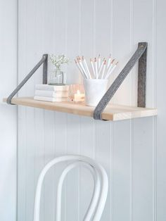 Add interest to plain walls with this on-trend contemporary hand-crafted shelf with grey supports.