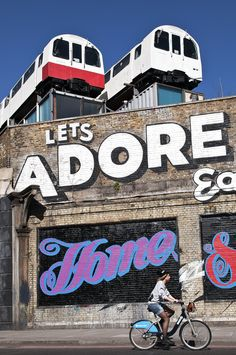 Shoreditch -old trains used as offices above a building. As seen on George Clarks amazing spaces channel 4 programme