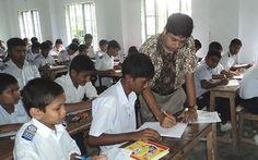Al Mamun, an English In Action Teacher Facilitator, with his class
