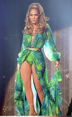 Jennifer Lopez hit the stage for her first-ever hometown concert in the Bronx, NY, in a leotard version of her infamous green jungle-print Versace gown that she wore to the Grammys 14 years ago.