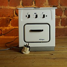 Mini Coocker 2017_179 Height:25cm  The mini stove is in new state and is a weird collectible object. In 1994, it was not allowed to be sold as children's toys by European legislation.