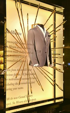 Ermenegildo Zegna windows 2014 Fall. Installed by Kitchen Stories, the multitude of golden needles are the signature of the brand that produces clothing of excellent quality measurement and tradition.