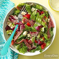 Antipasti Chopped Salad     1/3 cup EVOO     3 tablespoons red wine vinegar     2 cloves garlic, minced     1 head romaine, sliced crosswise     1/2 head radicchio, chopped     1 can (15.5 oz.) chickpeas, rinsed     6 ounces provolone or provolone picante, diced     1/2 cup drained, chopped jarred cherry peppers     4 ounces sliced salami, cut into strips