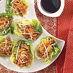 Asian turkey lettuce bowls;  Sautee 1.5 lbs turkey in 2 tablespoons  vegetable oil   with 1   onion, chopped &  2   cloves garlic, minced.  Add 1/2 cup  low-sodium chicken broth & 2 tablespoons  hoisin sauce, cook 5-7 min., Remove from heat add 2 tablespoons  teriyaki sauce, 1 cup  bean sprouts & 2   carrots, shredded.  Fill about  24   large Boston or butter lettuce leaves. k  Serve with soy sauce.    Soy sauce, optional