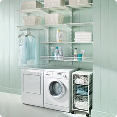 Easy and Inexpensive way to bring light and functionality to a garage laundry area. Paint the walls a relaxing color. You will always spend more time here than you want to, so why not enjoy it more. Laundry Room Colors, Laundry Room Art, Modern Laundry Rooms, Laundry Area, Laundry Room Design, Laundry Basket, Laundry Sorting, Basement Colors, Bathroom Laundry