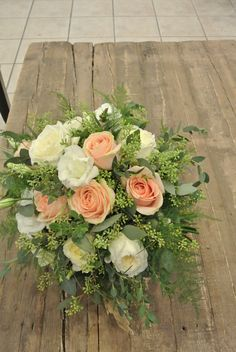 Bridal bouquet with roses and eucalyptus.Designed by Forget-Me-Not Flowers.