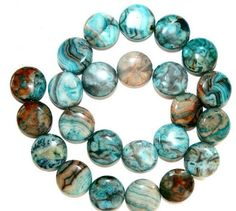 Blue Crazy Lace Agate Puffy Coin Beads, starting at $3 in the Supplies auction happening now!
