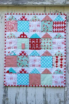 red and aqua houses - cute quilt - she has the dimensions and how she made her houses (but no tutorial) on this post