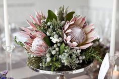 Beautiful Centerpiece Comprised Of: King Protea, Silver Brunia, Fresh Rosemary, Greenery & Foliage Flor Protea, Protea Bouquet, Protea Flower, Protea Wedding, Wedding Table Flowers, Wedding Table Centerpieces, Floral Wedding, Wedding Bouquets, Calla Lilies