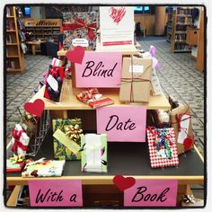 """Princeton Public Library's display for """"Blind Date with Book"""" Fun idea for a Valentine program, or just for any time. Teens can report back on how their """"date"""" went. Teen Library, Library Art, Library Design, Library Quotes, Cincinnati Library, Valentines Day Bulletin Board, School Library Displays, Library Bulletin Boards, Library Activities"""