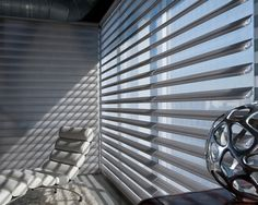 Stylish sophistication, modern functionality, a living room window treatment with a high design sensibility. Pirouette® window shadings ♦ Hunter Douglas window treatments