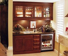 Small wall niche bar with two cabinets and sink Simple home bar designs Home bar lighting design
