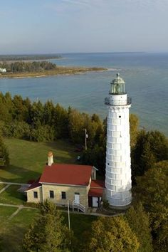Cana Island Lighthouse in Baileys Harbor, built in 1869, is one of the Great Lakes' most-photographed lighthouses. It's located in Door County, Wisconsin — which was named one of the best small towns in America by Fodor's.