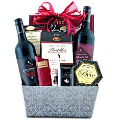 raffle prize- 2 wines, 2 glasses, chocolate, candles add some cheese in there