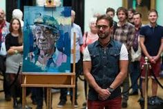 Christian Hook with his painting of Sir Ian Mckellan 2014.