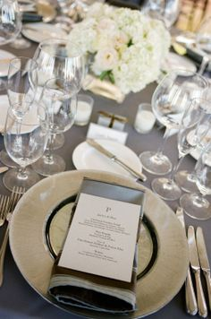 A grey linen paired with an ivory gold charger and grey menus create a beautiful Cape Cod themed wedding in the California Wine Country.