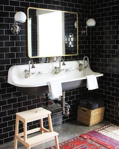 Still obsessed with the black floor-to-ceiling tile we installed in this bathroom last year!!  Link in profile with more pictures of this…