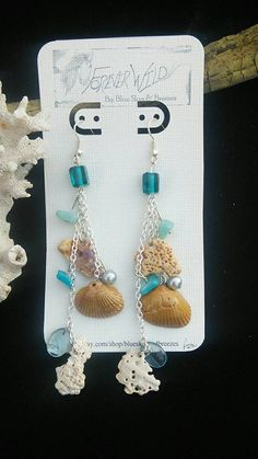 Check out this item in my Etsy shop https://www.etsy.com/listing/212095185/dangle-shell-earrings-4-long