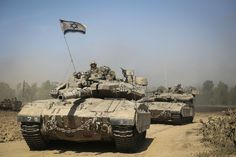 IDF modified Merkava 3 tanks moving to positions. Note additional ...