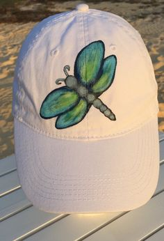 Items similar to Women's White Hat, Cotton Twill Cap, Hand Painted Blue Dragonfly on Etsy Sun Visor Hat, Visor Hats, Painted Canvas, Hand Painted, Painted Hats, Damselflies, Blue Dragonfly, Hat Embroidery, Clothing Hacks