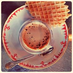 I worship thee, my espresso! Here it comes in a double walled glas on a KPM Berlin saucer. - And don't forget to have sweets with your coffee!