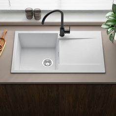 This Reginox sink is made from extremely durable granite composite, making it scratch, stain and impact resistant. The white granite finish will look at home in any modern kitchen! Small Kitchen Sink, Granite Kitchen Sinks, Kitchen Taps, Beautiful Kitchen Designs, Beautiful Kitchens, House Extension Plans, Undermount Stainless Steel Sink, Shower Fittings, Single Bowl Sink