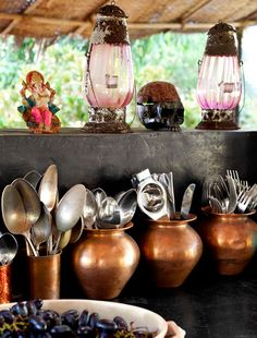 Jade Jagger's home in Goa, India - love the copper pots to hold cutlery