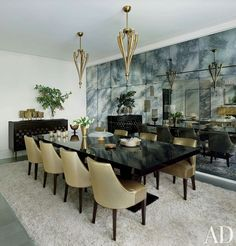 Architect David Mann Remakes a New York Apartment : Architectural Digest, Darcy Miller & Andy Nussbaum, Antiqued mirror lines a wall of the dining area, where chandeliers from Bernd Goeckler join tables by Daniel Scuderi Antiques. Elegant Dining Room, Dark Dining Room, Luxury Dining Room, Dining Room Design, Elegant Dining, Modern Dining Table, Dining Room Decor, Black Dining Room, Dining Room Sets