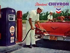 Vintage gas station attendant.  Red Chevy convertible.